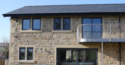 House with aluminium tilt turn windows