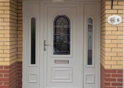 PVC front door with decorative panel sidelights