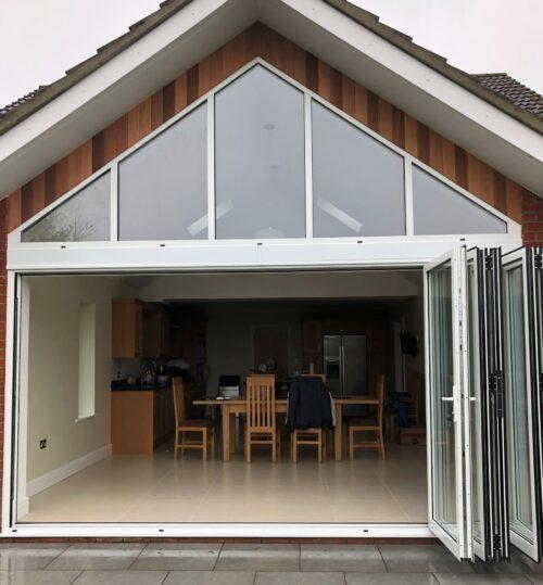 Folding sliding doors with fixed gable window