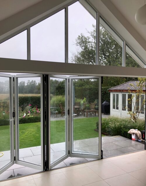 View from sliding folding doors in kitchen with gable